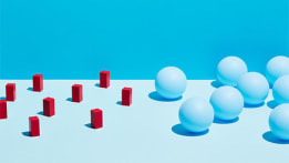 red cylinders and white balls on light blue backdrop