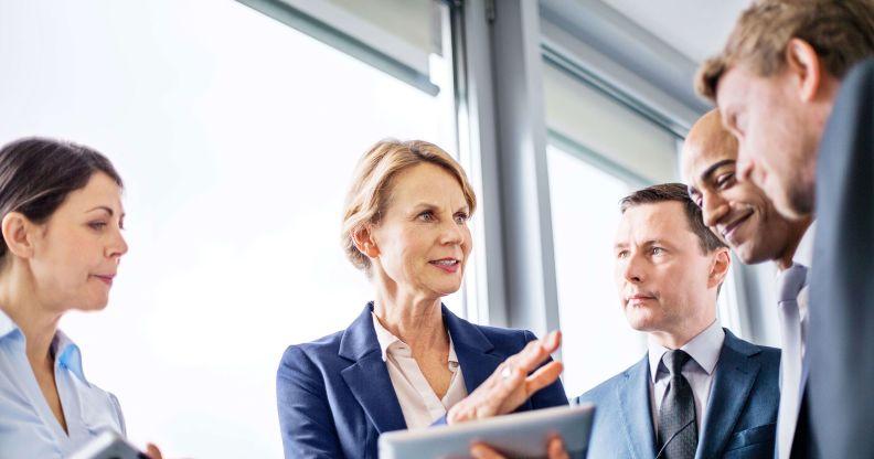 Female executive leads discussion
