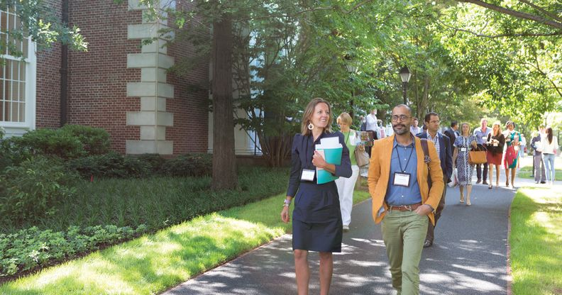 Harvard executive education participants walking on campus