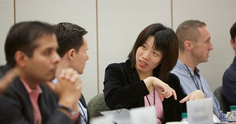 close up of male and female Harvard executive educatiom participants in the classroom