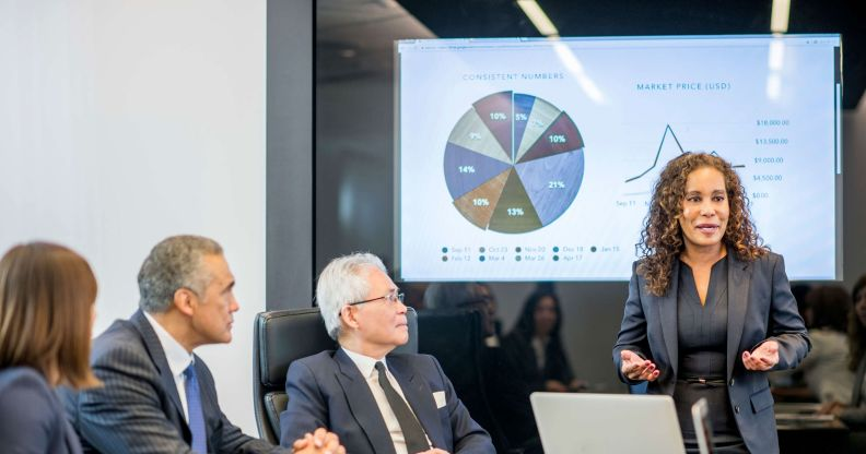 Female executive presents data to the group