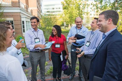 participants at an outdoor social gathering during the Global Alumni Leadership Summit at Harvard Business School