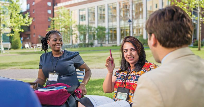 Harvard executive education participants engaged in discussion on campus