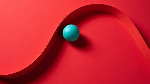 a blue ball on a two-tiered curved red field