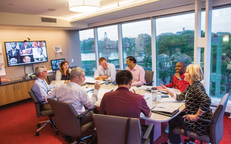 diverse group of Harvard executive education participants in living group discussion