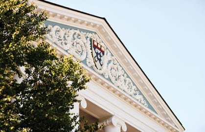 Leadership topic image, Baker Library frieze and shield, HBS campus