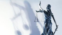 looking from behind of lady justice against white background