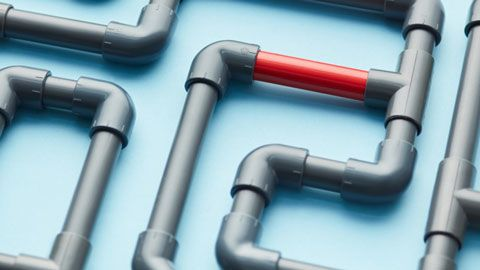 grey connecting pvc pipes with one red section