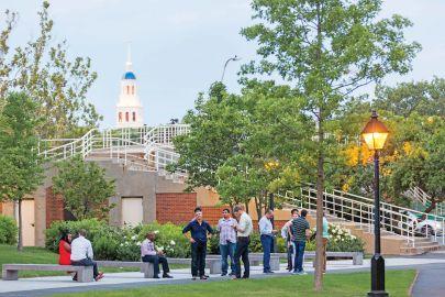 executive education program participants gathered near the Weeks footbridge